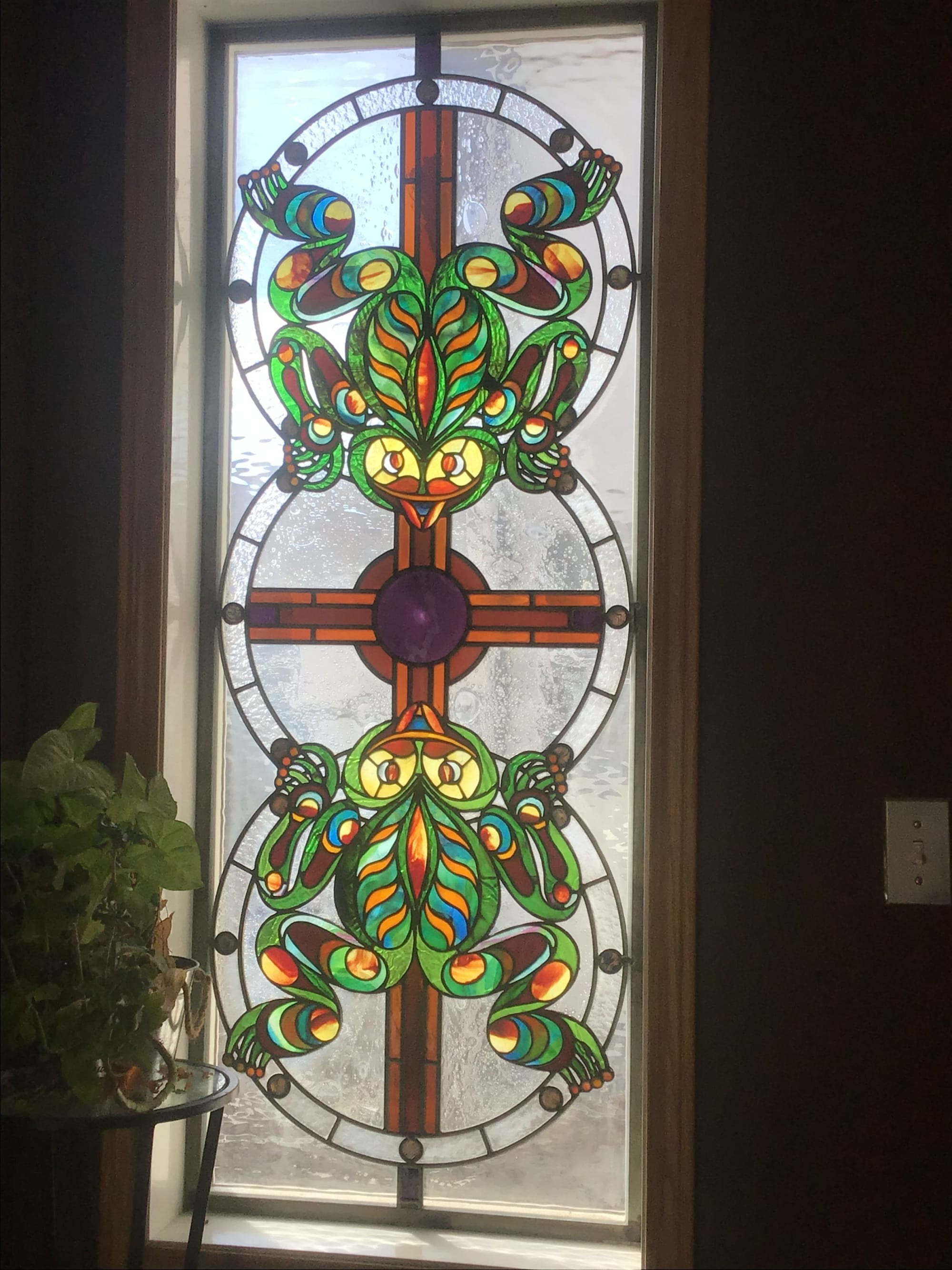 Stained glass window with 2 frogs