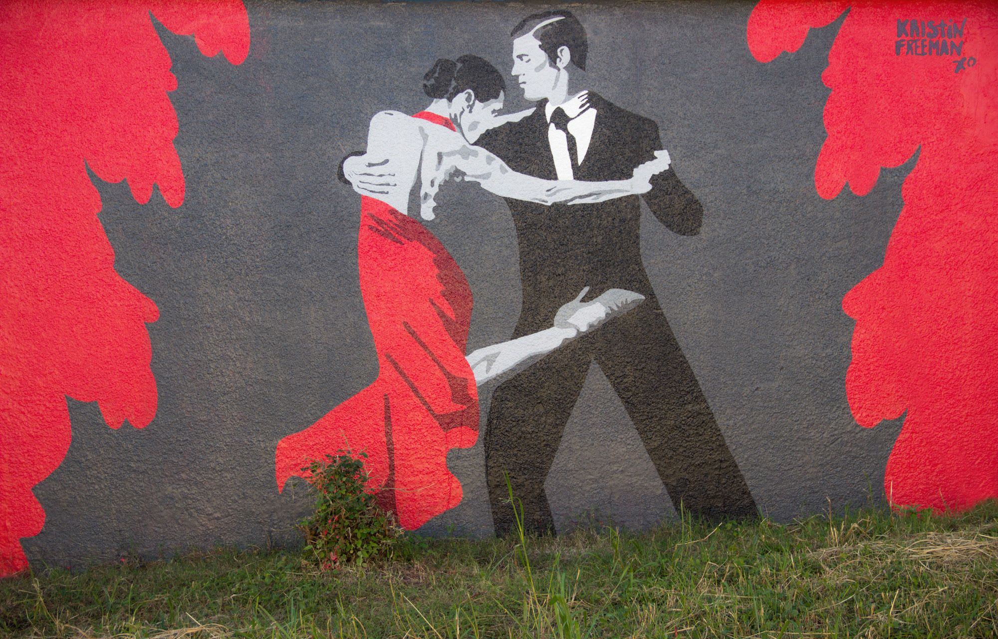 Larger than life red black white tango mural