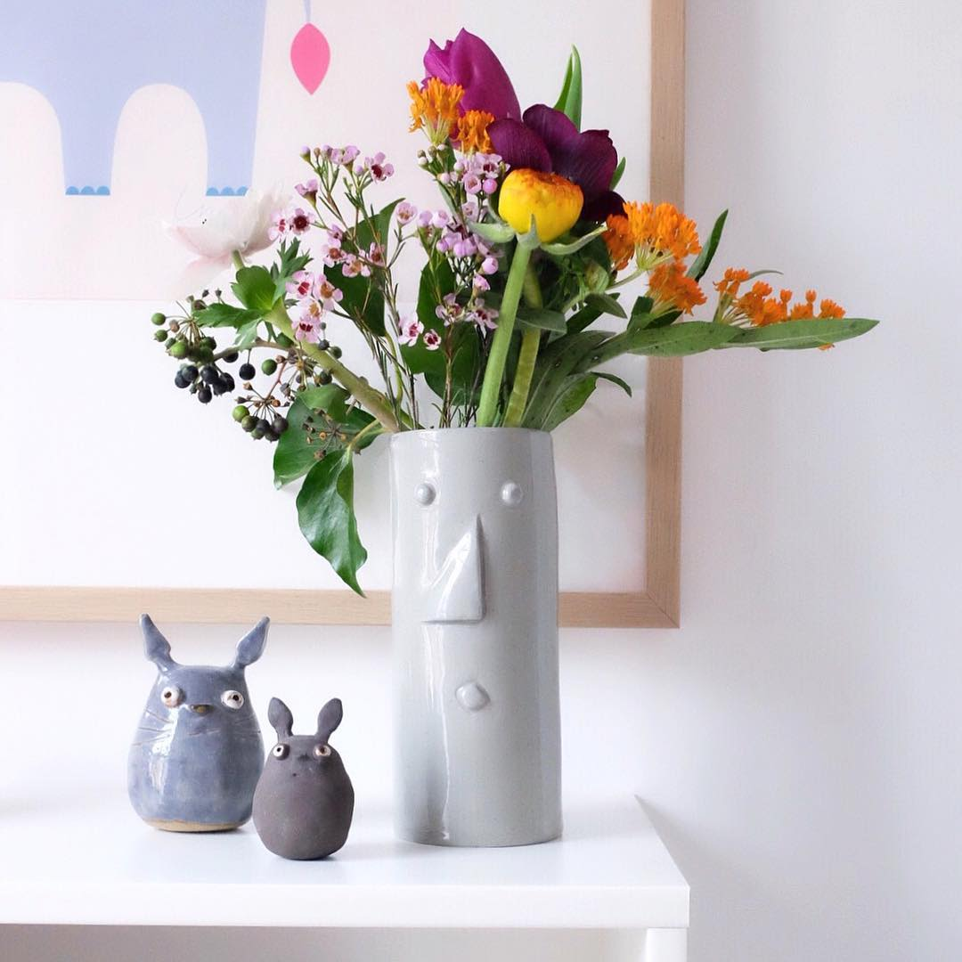Tall Cylindrical Flower Vase with a Face in Gray