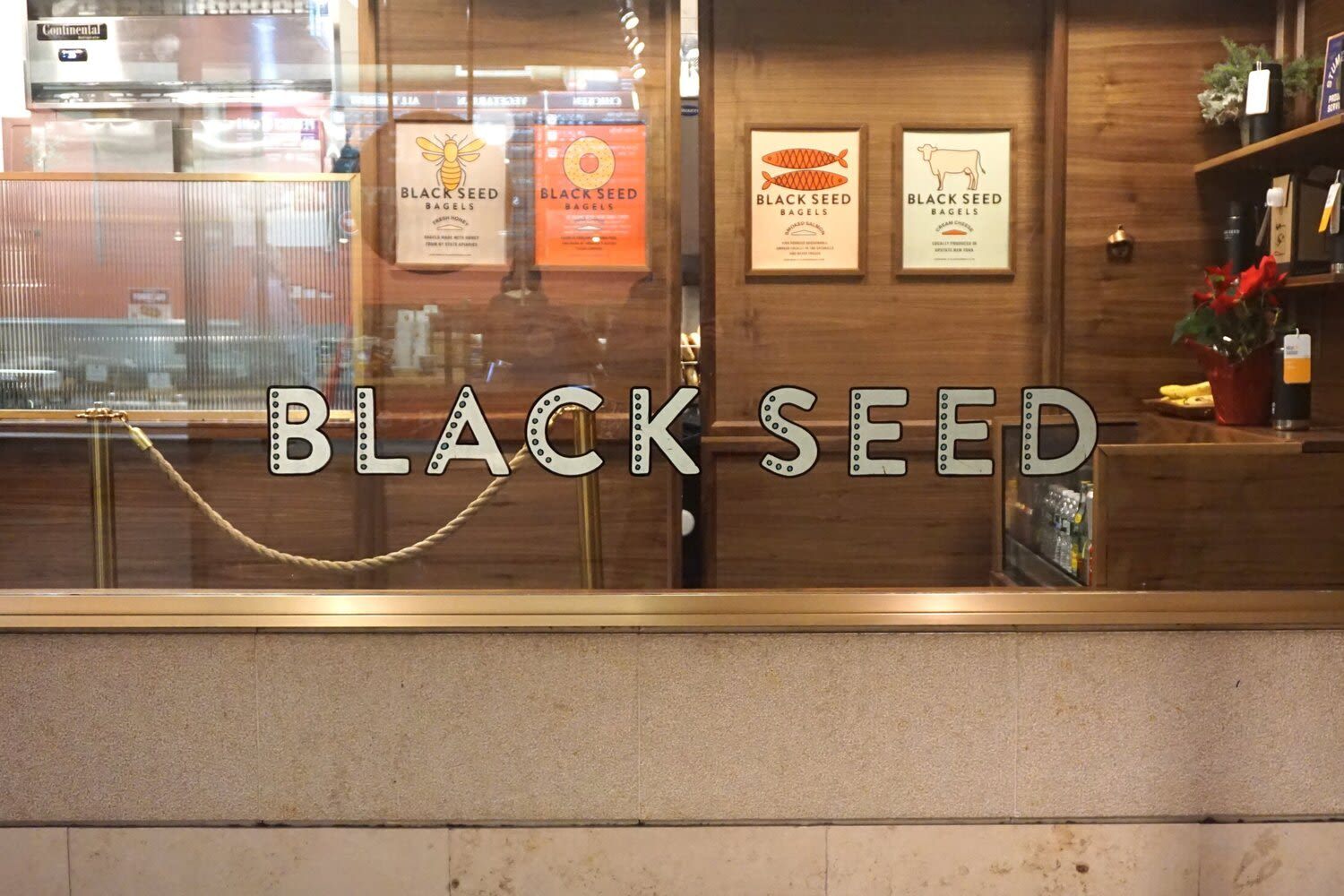 Signage by Noble Signs seen at Black seed bagels, New York - Black Seed Rockefeller Center