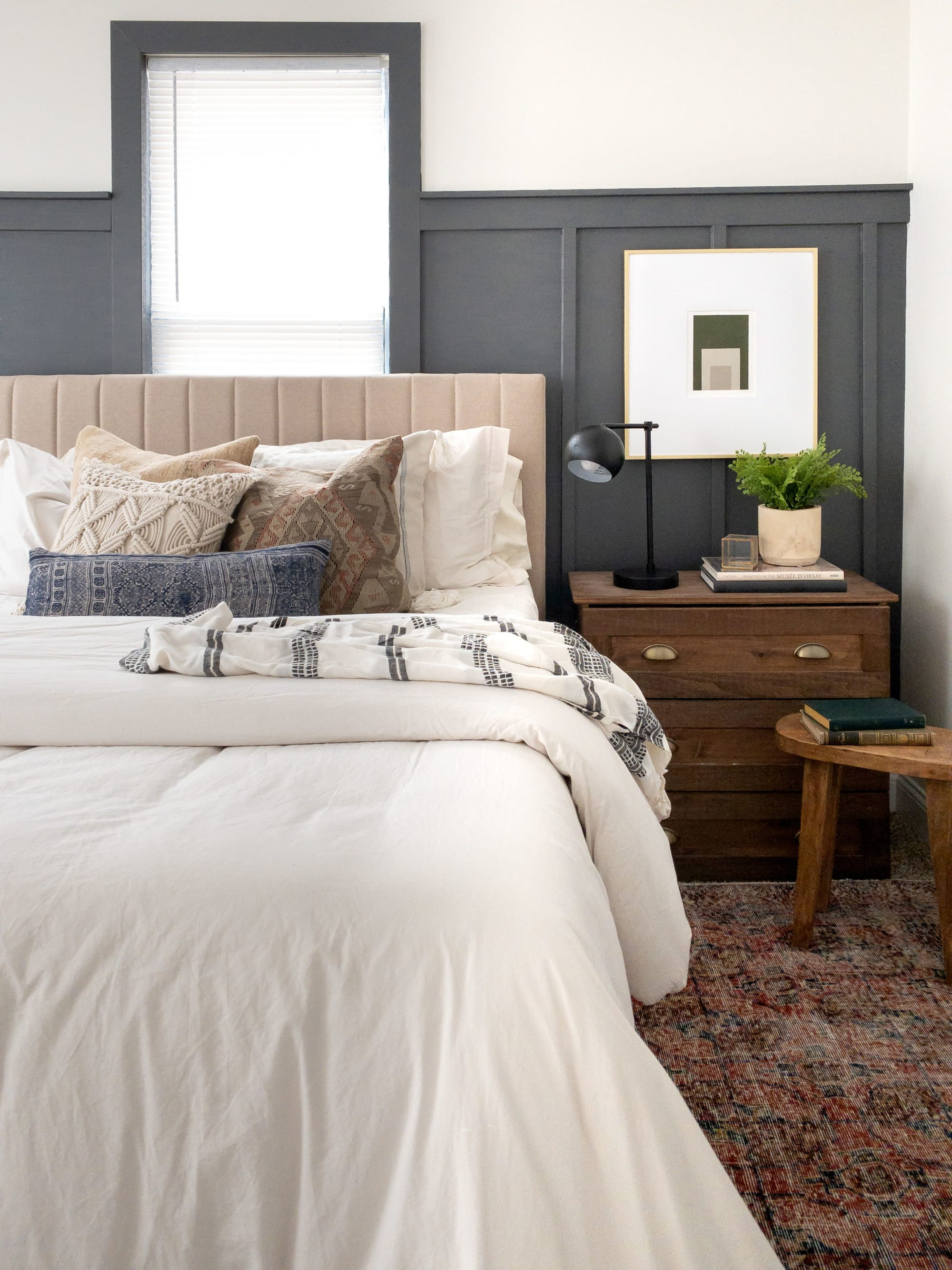 Off white bedding and bohemian pillows