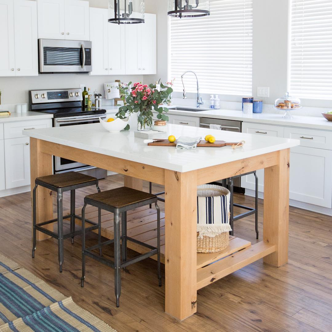 Natural wood kitchen table white countertop