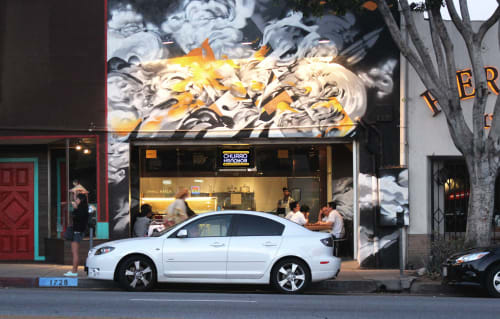 Murals by Hueman, Allison Torneros seen at Churro Borough, Los Angeles - Mottled Black, Gray and Yellow Murals