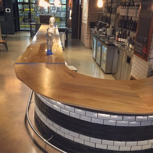 Tables by Jason Lewis seen at Goose Island Beer Company, Chicago - Curved Live Edge Bar Top