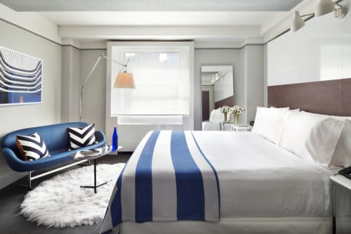 Linens & Bedding by Archipelago Designs seen at Paramount Hotel, New York - Cotton Striped Throws and Egyptian Cotton Pillows