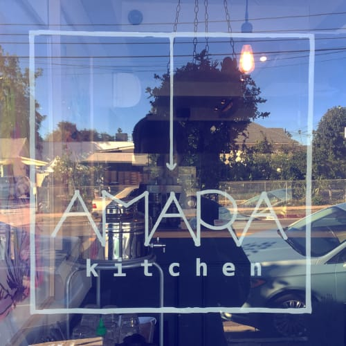 Signage by Leaf Cutter Studio seen at Amara Kitchen, Los Angeles - Window Sign