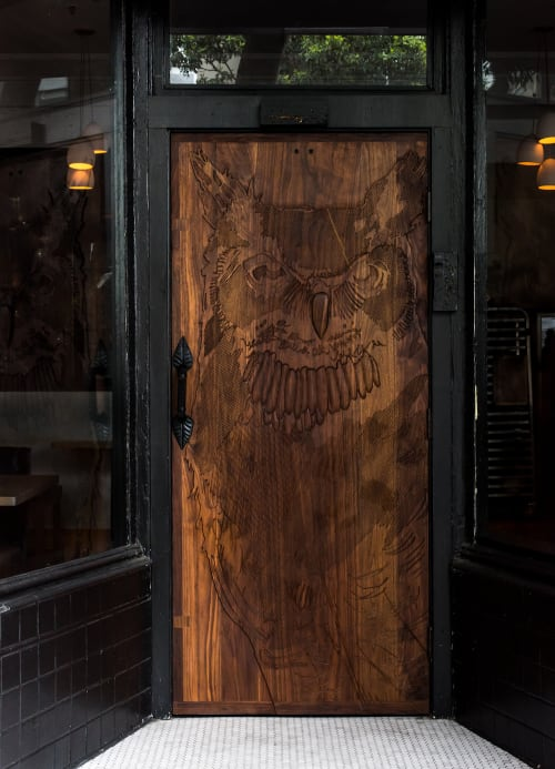 Furniture by Tyler Speir Bradford seen at Nightbird, San Francisco - Custom-carved Wood Door