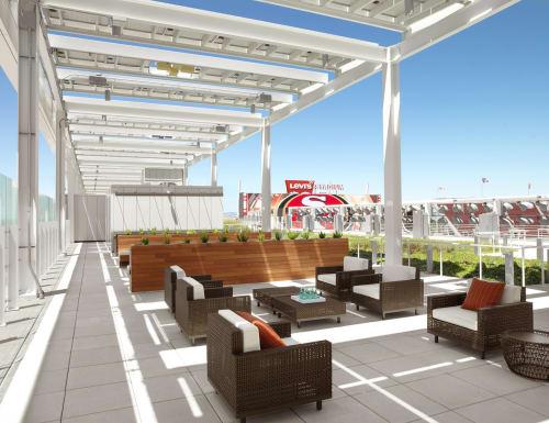 Furniture by Janice Feldman of JANUS et Cie seen at Levi's Stadium's NRG Solar Terrace, Santa Clara - Boxwood Lounge Chairs