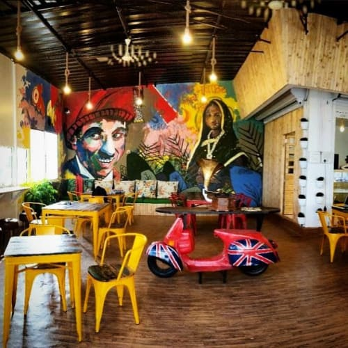 Murals by nileshartist seen at Cafe Brew Barn, Pimpri-Chinchwad - Monalisa and Charlie Chaplin Mural