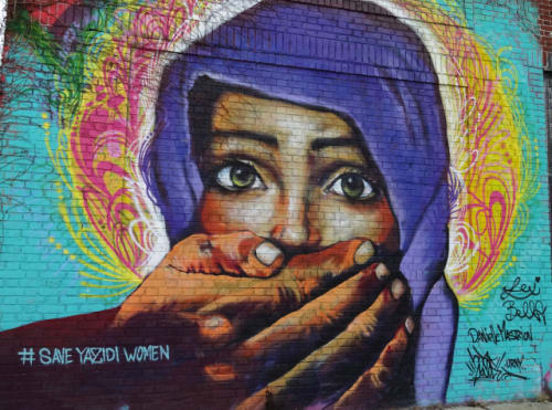 Murals by UR New York (URNY) seen at Welling Court Mural Project, Queens - Save Yazidi Women