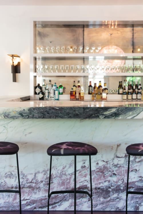 Tables by ABC Stone seen at Hotel Tivoli, Tivoli - Fior di Pesco Apuano Stone