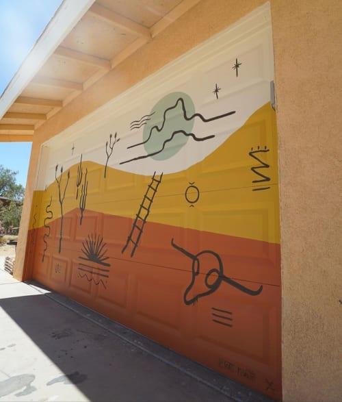 Murals by Prescott McCarthy seen at Joshua Tree National Park - Garage Door Mural