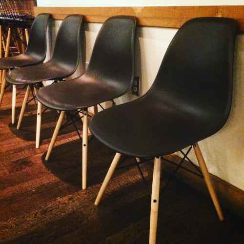 Chairs by Charles and Ray Eames seen at Piccino, San Francisco - Eames Molded Plastic Dowel-Leg Side Chair