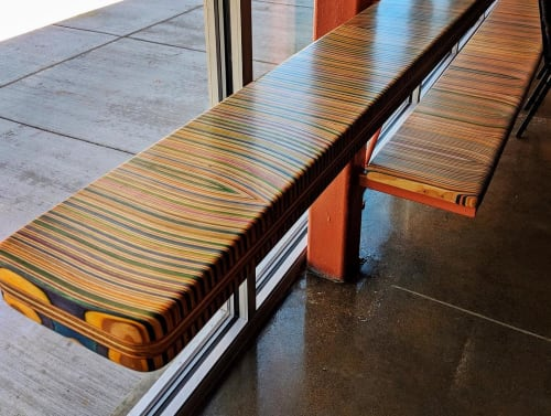Tables by Iris Skateboards seen at The Edge Theater, Chicago - Cantilevered Recycled Skateboard Countertops and Benches