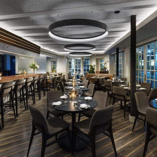 Chandeliers by CP Lighting seen at Mediterraneo Restaurant, Greenwich - Custom Aluminum Circle Fixtures