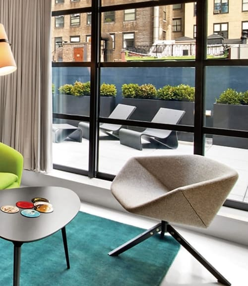 Chairs by Niels Bendtsen seen at The William NYC, New York - Ella Easy Chair