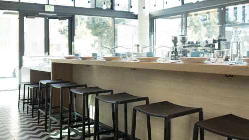Chairs by Fyrn seen at Noon All Day, San Francisco - Bartlett Backless Bar Stool & De Haro Backless Counter Stool