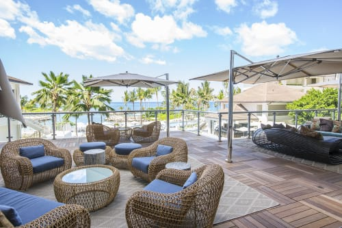 Chairs by Kenneth Cobonpue seen at Four Seasons Resort Oahu at Ko Olina, Kapolei - Balou Easy Armchair, Ottoman and Coffee Table