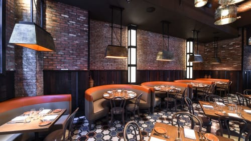 Lighting by Focus Lighting seen at GATO, New York - Geometric trapezoidal brass fixtures