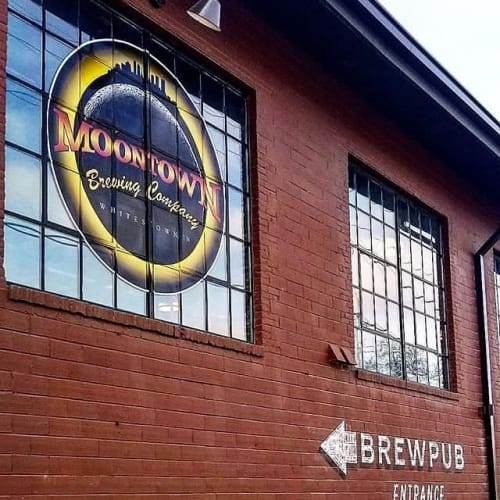 Signage by Cary Walker seen at Moontown Brewing Company, Whitestown - Logo Design