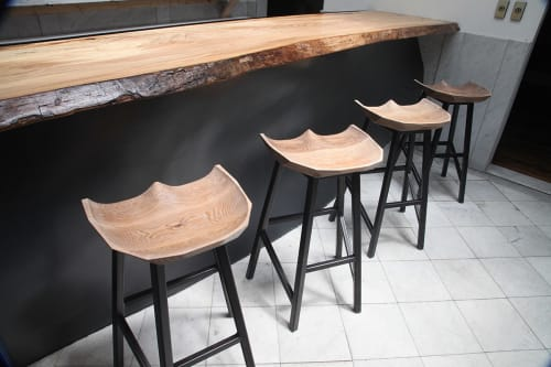 Chairs by Goebel & Co. Furniture seen at The BHIVE, St. Louis - Cruz Facet Stool with Custom Tables
