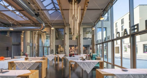 Pendants by RIBAG seen at Restaurant Aeschbachhalle 6 AG, Aarau - Clustered AROA Lamps