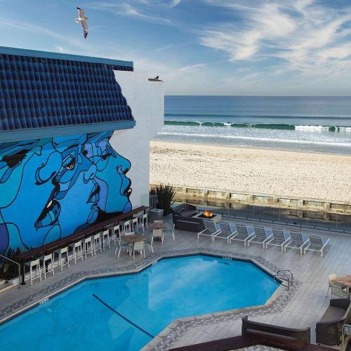 Murals by David P. Flores seen at Blue Sea Beach Hotel, Pacific Beach, San Diego - Sirens
