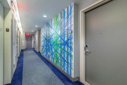Murals by Carl Yoshihara seen at Courtyard by Marriott New York Downtown Manhattan/World Trade Center Area, New York - Cascade Deconstructed - Line Series (Corridors)