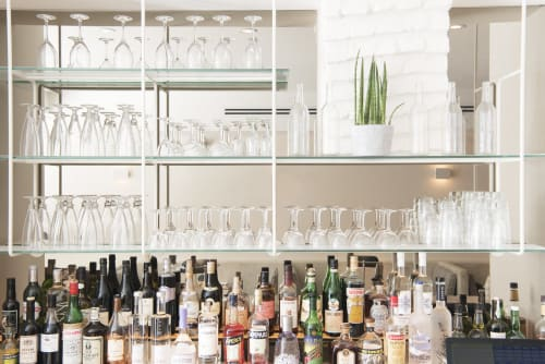 Interior Design by Elizabeth Roberts Architecture & Design seen at Nix, New York - Custom Steel and Glass Shelves