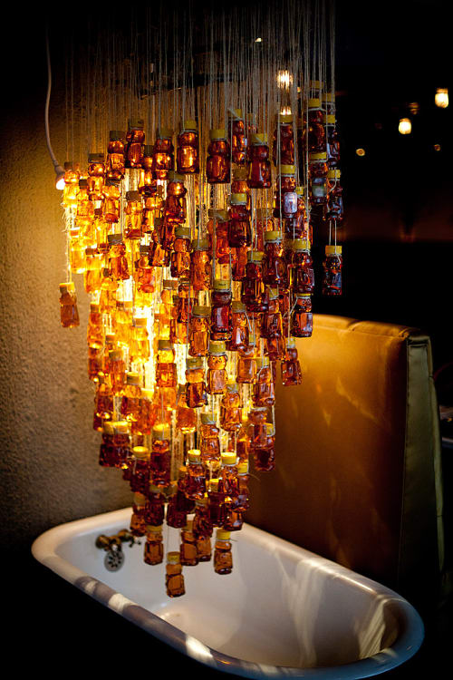 Lighting by FLO Design Studio seen at Industriel Urban Farm Cuisine, Los Angeles - Bear Shaped Honey Jars