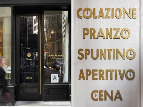 Signage by Pentagram seen at La Pecora Bianca, New York - Storefront Window Signage