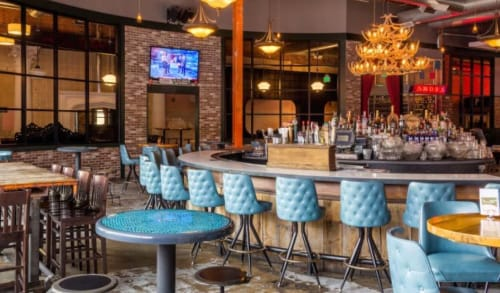 Chairs by American Chairs seen at Punch Bowl Social Denver, Denver - Tufted Back Bar Stools