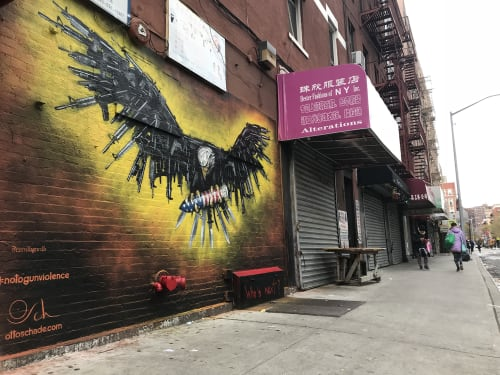 "Street Murals by Otto Schade seen at Chinatown, New York - ""Who's next?"""