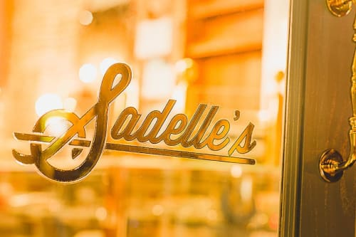 Signage by Lesley Johnson at Sadelle's, New York - Storefront Windows Custom Sign