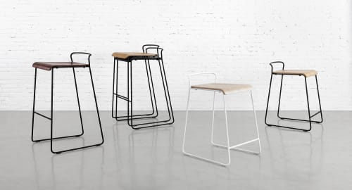 Chairs by m.a.d. furniture design at Airbnb Ireland, Dublin 4 - Transit Bar Stools