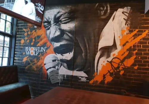 Murals by Rogueoner seen at The Howlin' Wolf, Glasgow - Chester Arthur Burnett