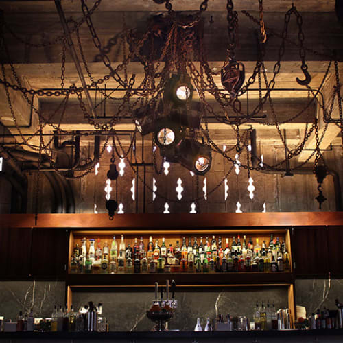 Lighting by Michael Schmidt seen at Ace Hotel LA, Los Angeles - Rusted-Metal Chains And Lighting Fixtures