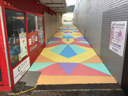 Street Murals by Ayjay seen at PhysioHealth & Sports Injury Clinic, Corrimal - Inside Out