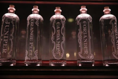 Tableware by Reclamation Etchworks seen at Whitechapel, San Francisco - Etched distillate bottles