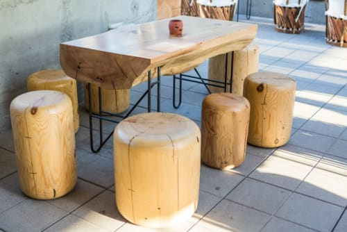 Chairs by Alma Allen seen at Ace Hotel LA, Los Angeles - Organic Wood Stools