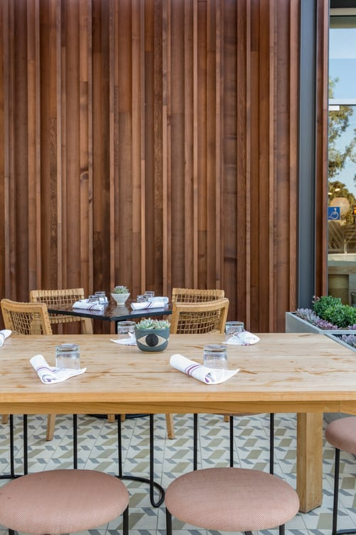 Tables by Wendy Haworth Design seen at Gratitude Newport Beach, Newport Beach - Reclaimed Wooden Communal Tables