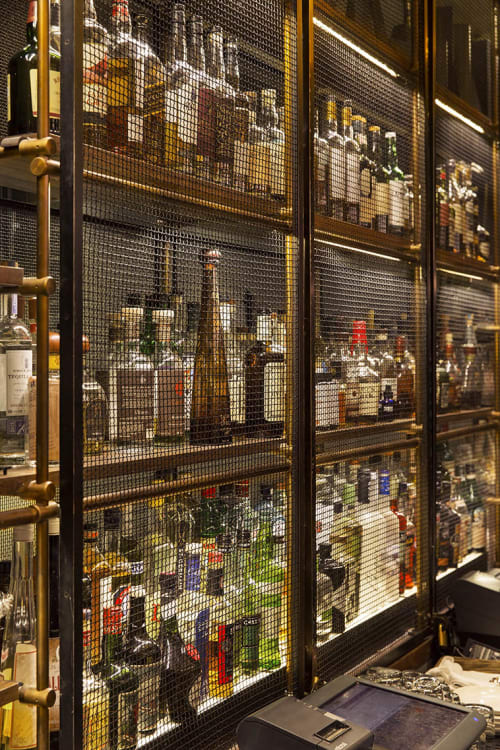 Hardware by Amuneal seen at Kimpton Hotel Eventi, New York - Eventi Hotel Collector's Shelving System