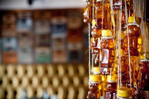 Lighting by FLO Design Studio seen at Industriel Urban Farm Cuisine, Los Angeles - Bear Shaped Honey Jars