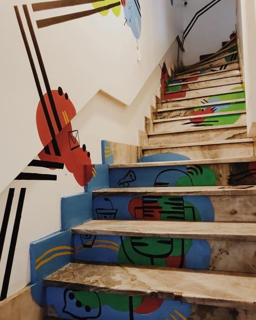 Murals by Marti Fiorentino seen at Cumbre Comunicación Política - Stair Mural