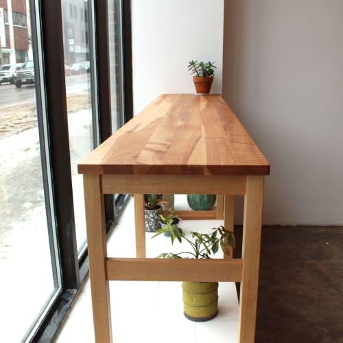 Tables by Emma Senft seen at Aliments Viens, Montréal - Standing Bar