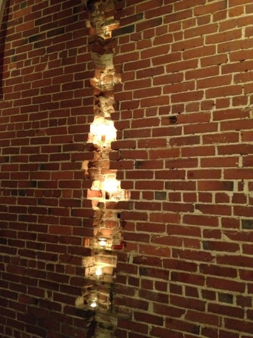 Furniture by TRUE Handcrafted seen at The Port Hunter, Edgartown - Brick Wall Crack Candle Stack