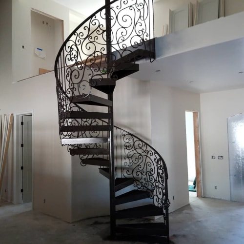 Sculptures by Iron Maverick seen at Private Residence, Carmichael - Spiral Staircase