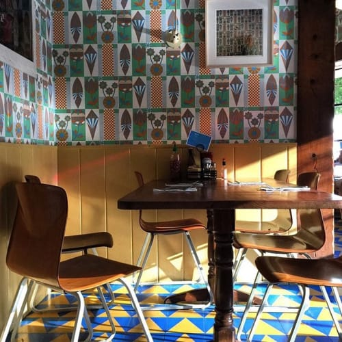 Wallpaper by Geoff McFetridge seen at Beachwood Café, Los Angeles - Surfboards and Flowers