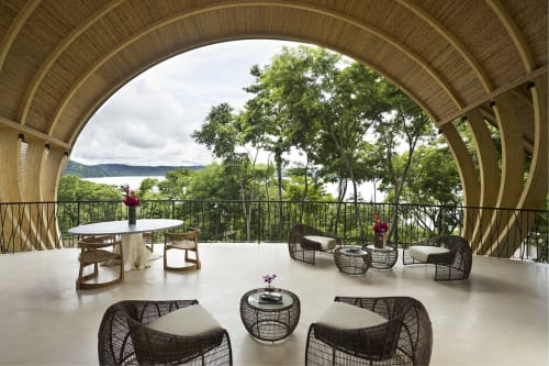 Chairs by Kenneth Cobonpue at Andaz Peninsula Papagayo Resort, Papagayo Peninsula - Croissant Easy Armchair and End Table