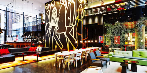 Murals by Julian Opie seen at citizenM New York, New York - People Walking